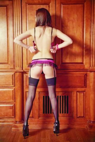 Izmir escort Eleanor: incredible girl, sexy red underwear, bra undone, frank posture; Eleanor – attractive smile, predatory gaze