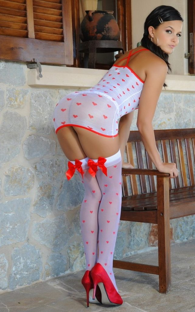 Izmir escort girl Rita in white and red lingerie, lacy lingerie, seductive lingerie, girl in stockings with bows, red shoes, woman with shapely legs