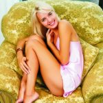 Izmir escort girl Lydia is sitting in the chair with a broad smile, this charming girl in a pink silk dress looks incredibly sexy, and she demonstrates her open and cheerful character