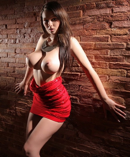Escort girls in Izmir present pussy Victoria that on this picture stands with the naked breasts and half-downed sexy red dress