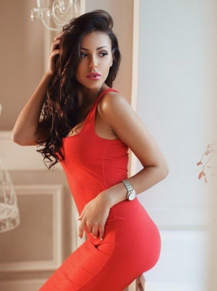 Escort girls Izmir present maiden Renata that looks stunningly beautiful in this red dress that makes you want this girl right now