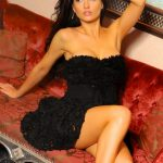 Lola from Izmir escorts is sitting on a couch and as if requesting you to pick up a phone and to order her immediately