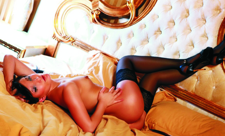 Izmir Russian escort presents lassie Katrine that is laying on the bed with wonderful bedclothes completely naked and revealing her all to you