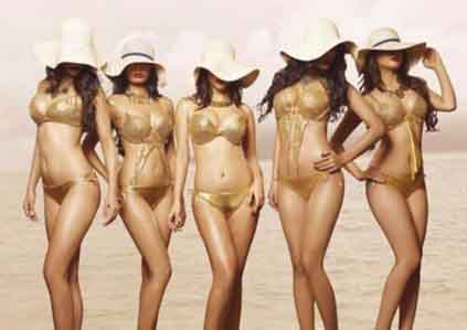 Izmir escort girls are standing dressed in golden swimsuits to your delight, covering their faces with longhaired hat