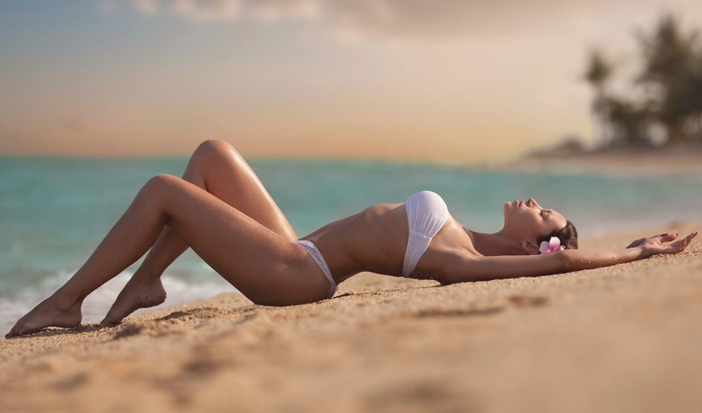 Russian escort Istanbul beautiful girl resting on the beach, her sexy body looks incredibly tempting and attractive