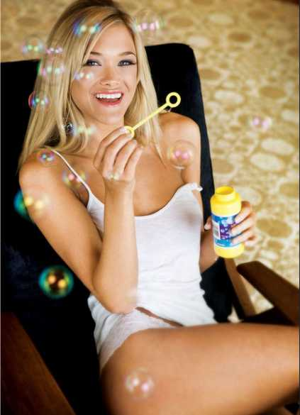 One of Izmir agency girls shows fabulous smile during laugh producing soap bubbles and wearing so little cloth that it resembles some bachelorette party