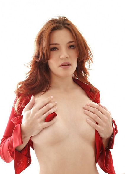 Girl in escort Lina is standing covering her naked boobs with own palms dreaming of having sex with you