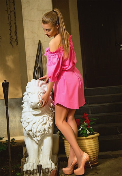 Escort Whatsapp Kristina wears pink dress that magnificently suits her image and character in this picture