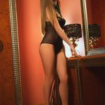One of Whatsapp girls Kristina is near the big-sized mirror to look at her reflection and make you excited about it