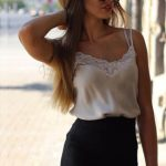 Incall escort agency paramour Elena takes her hair back, opening the smile and light blouse