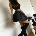 Incall escorts Angelica wears high heels and short dress, under which it is so easy to feel her flesh