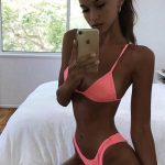 Russia escort agency sweetheart Alyona takes another selfie shot wearing a pink swimsuit