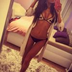 Izmir escorts agency girl Vita takes a pic of her body in underwear standing barefoot on a carpet