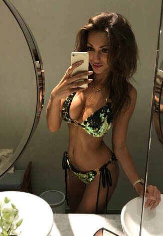 Incall escorts girl Angelica makes a picture of self, standing in underwear in a bathroom