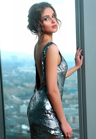 VIP escort bayan Liana is a totally beautiful girl who is wearing now sparkling silver dress