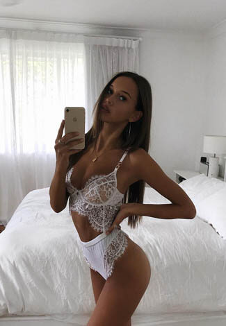Russia escort agency love giver Alyona takes a picture of herself wearing white underwear