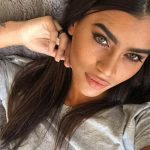 Outcall escort service chick is in the bed lifting her gaze up