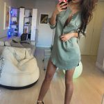 Incall escorts girl Angelica makes a picture of herself wearing just regular dress standing in a room