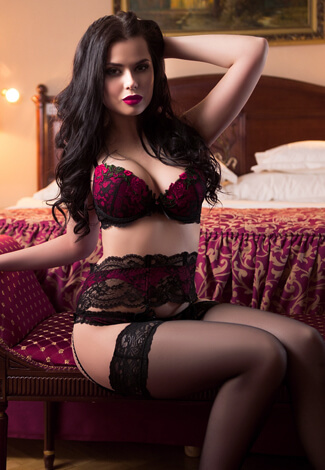 VIP escort bayan Nicole is wearing erotic and flamboyant lingerie of expensive color