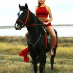 Izmir escort girl Julianna is on the horse riding and smiling
