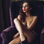 Izmir BDSM escort Milia is naked in the chair enjoying the picture of a fading day